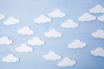 white clouds on a blue wooden background