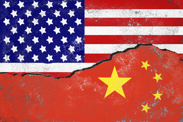 USA and China conflict concept.Flags of USA and China painted on cracked wall