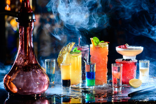 Set of alcoholic cocktails in a hookah with beautiful smoke and space for text.