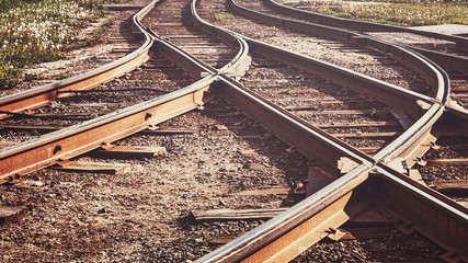 Foto auf Acrylglas Eisenbahnschienen A railway track litted by the sun, toned.