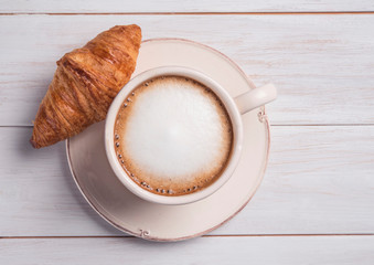 coffe and croissant wood background morning breakfast top view