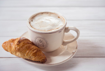 coffe and croissant wood background morning breakfast