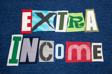 EXTRA INCOME text word colorful fabric collage on blue denim, side hustle, horizontal aspect