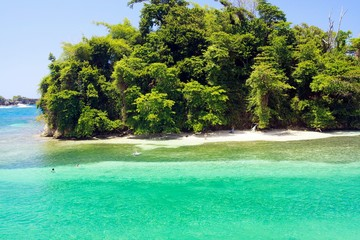 View on secluded islet with white sand and turquoise water - Port Antonio, San San Beach, Jamaica
