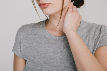 Close up picture of young woman with neckache isolated