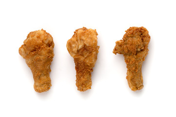 Fried legs on a white background. Chicken legs deep fried close-up.
