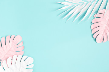 Summer composition. Palm leaves on blue background. Summer concept. Flat lay, top view, copy space