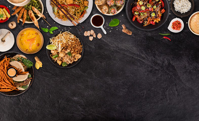 Asian food background with various ingredients on rustic stone background , top view. Vietnam and Thai cuisine.