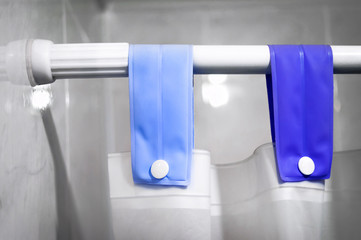 Shower Curtain Rod, Blue Fabric Loops, White Buttons and Shower Curtain. Wall mural