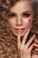 Pretty girl with curls hairstyle, classic makeup, freckles, nude lips Beauty face.