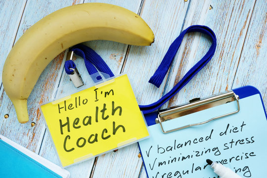 Health coach badge and check list with clipboard.