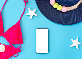 Wall Mural - summer blue banner with navy blue hat ,pink bikini,tablet ,sunglasses and seashell on blue background top view mock up screen