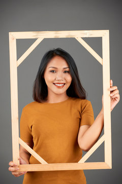 Woman posing with frame