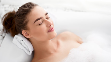 Woman Relaxing In Bath. Girl Bathing With Closed Eyes