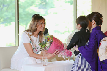U.S. first lady Melania Trump receives a flower bouquet while attending a cultural programme at Akasaka State Guest House in Tokyo