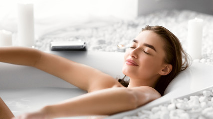 Woman Enjoying Milky Bath After Work Day