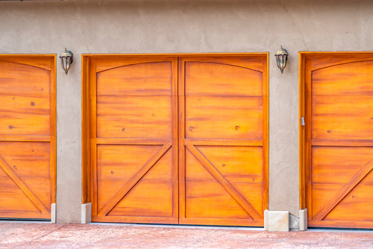Close up view of the brown wooden garage door at the exterior of a house