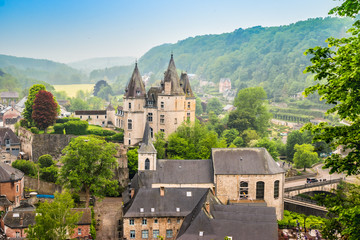 Fotomurales - Durbuy, Walloon city in the Belgian province of Luxembourg. Beautiful medieval castle in the city centre.
