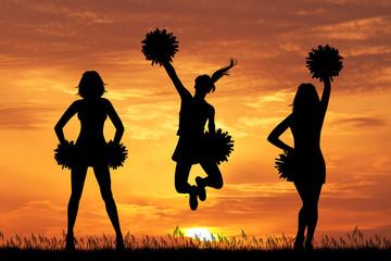 illustration of cheerleader silhouette at sunset