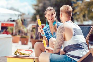 Couple enjoying popsicle
