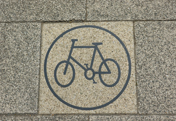 Cycle sign on a paving stone