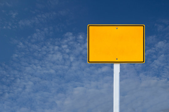 blank yellow sign on blue sky