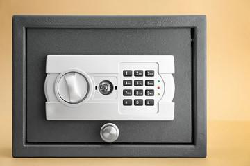 Modern safe on color background