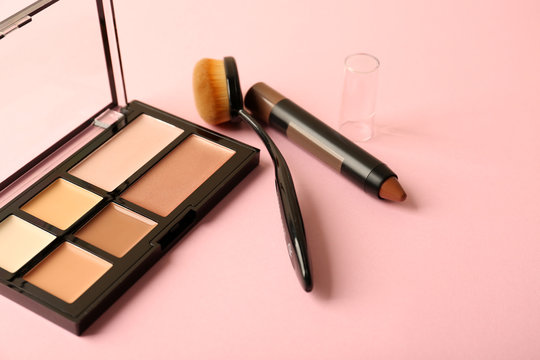 Set of cosmetics for contouring makeup on color background