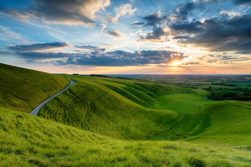 Wall Mural - Dramatic sunset sky over The Manger at Uffington