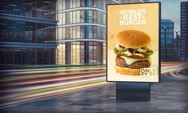 Advertising burger billboard in city night