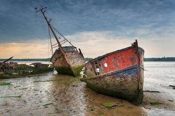 Acrylic Prints Shipwreck Old boat wrecks under a stormy sky