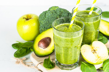 Green smoothie from fruit and vegetable on white.
