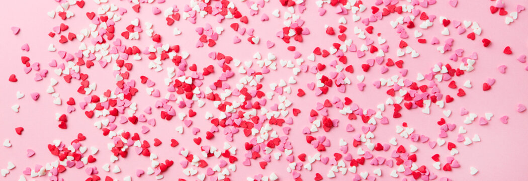Sugar hearts on pink background. Romantic, St Valentines day concept. Top view.