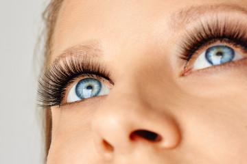 Female eyes with extreme long false eyelashes. Eyelash extensions, make-up, cosmetics, beauty