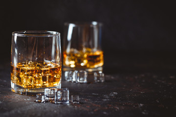 Glasses of whiskey with ice