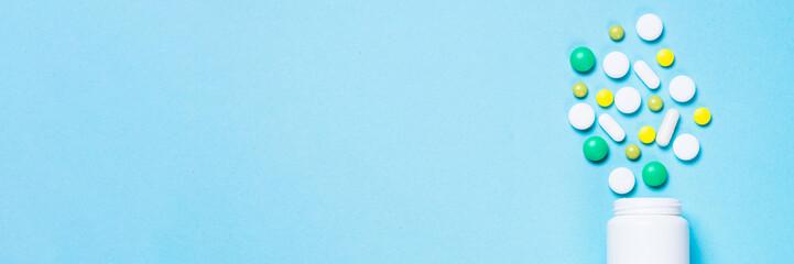 Fototapeta Pills, tablets and vitamin on blue obraz