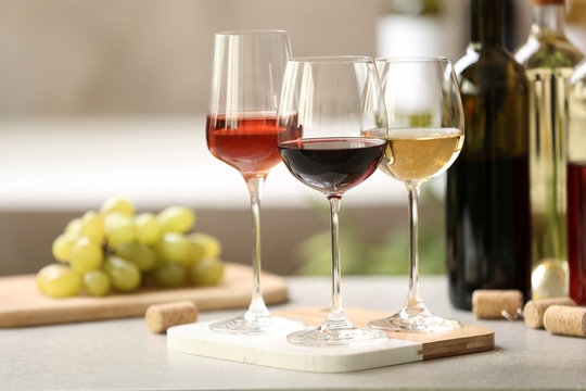 Different glasses with wine served on table