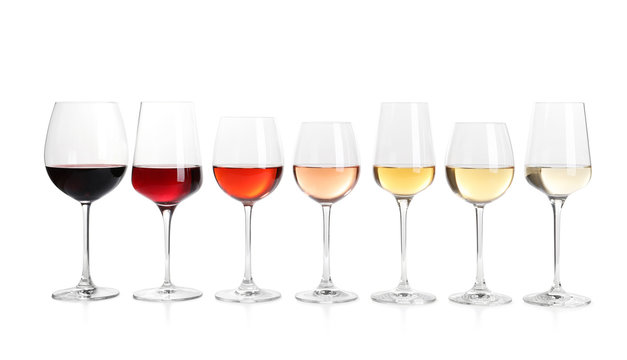 Row of glasses with different wines on white background