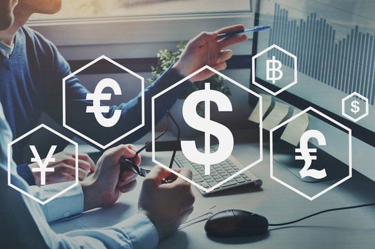 money exchange or forex concept, different foreign currencies, dollar, euro and pound, business people doing financial analytics on background