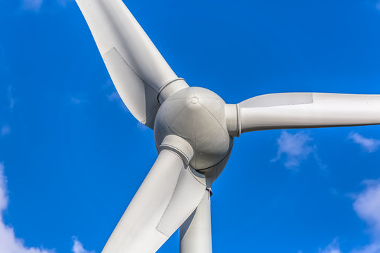 Detailed close up view of a wind turbines; generator, rotor and blade view