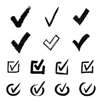 Vector collection of hand drawn check (V) signs isolated on white background