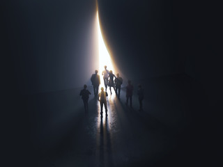 group of people at the door leading to the light
