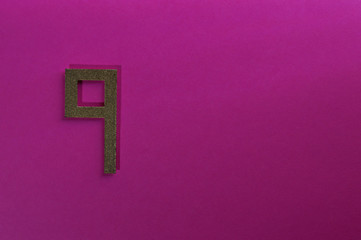 gold number nine on pink background