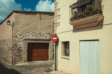 Alley with old houses and no entry traffic sign at Caceres