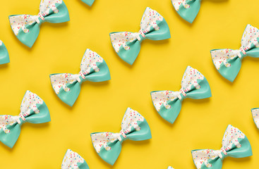 Cute hair bow pattern on bright background, flat lay