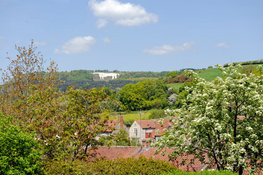 View across the rooftops of the iconic White Horse image on the hillside above the village of Kilburn in North Yorkshire, England