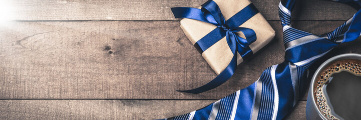 Gift Box Tie And Hot Coffee On Wooden Table With Sunlight - Fathers Day Concept