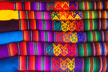 Peruvian traditional colorful native handicraft textile fabric at market in Machu Picchu, one of the New Seven Wonder of The World, Cusco Region Peru, South America. Selective focus, Close up.