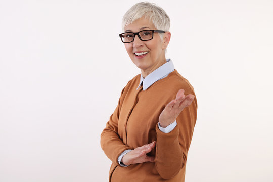 Smiling Mature Woman wearing glasses on white background,casual elegant style .