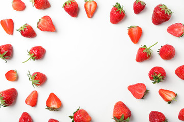 Flat lay composition with strawberries on white background, space for text. Summer sweet fruits and berries Wall mural